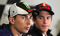 Yamaha MotoGP rider Jorge Lorenzo of Spain talks as Honda MotoGP rider Marc Marquez of Spain listens during the official press conference ahead of the Australian Grand Prix in Phillip Island near Melbourne October 17, 2013. IMAGE RESTRICTED TO EDITORIAL USE ONLY- STRICTLY NO COMMERCIAL USE. Photo by Daniel Munoz/VIEWpress