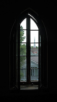 Abandoned classroom window overlooking another church in downtown Vicksburg Mississippi.