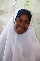 Jambiani, Zanzibar, Tanzania.  African Muslim Primary school teacher.