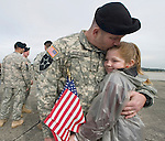 Sgt. 1st Class Wade Breaud hugs his 10-year-old daughter Emily after welcome home ceremonies for the 3rd Brigade , 2nd Infantry Division at Fort Lewis in Tacoma, Washington on October 11, 2007. Soldiers from the 3rd Stryker Brigade were deployed in Iraq from June 2006 to September 2007. (UPI Photo/Jim Bryant).