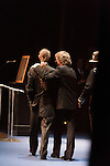 September 26, 2013. Raleigh, North Carolina.<br />  Tony Rice, left, takes the stage to accept his induction into the International Bluegrass Music Hall of Fame. Sam Bush, center, and Ricky Skaggs introduced him to the sold out crowd.<br />  Bluegrass guitar legend Tony Rice was inducted into the International Bluegrass Music Hall of Fame during the International Bluegrass Music Awards, held in Memorial Hall at the Duke Energy Center for the Performing Arts.
