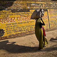 Woman carrying goods in the traditional way along a street in Agra. (Photo by Matt Considine - Images of Asia Collection)