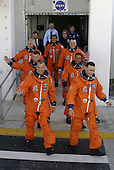 Cape Canaveral, FL - March 15, 2009 - The crew members of the STS-119 mission stride out of the Operations and Checkout Building at NASA's Kennedy Space Center in Florida, heading for the Astrovan that will take them to Launch Pad 39A. Clockwise from left are Pilot Tony Antonelli, Mission Specialists Steve Swanson, John Phillips, Koichi Wakata, Richard Arnold and Joseph Acaba, and Commander Lee Archambault. Wakata represents the Japan Aerospace Exploration Agency and will remain on the International Space Station, replacing Expedition 18 Flight Engineer Sandra Magnus, who returns to Earth with the STS-119 crew. Liftoff of Discovery is scheduled for 7:43 p.m. EDT, Sunday, March 15, 2009. The STS-119 mission is the 28th to the space station and the 125th space shuttle flight. Discovery will deliver the final pair of power-generating solar array wings and the S6 truss segment. Installation of S6 will signal the station's readiness to house a six-member crew for conducting increased science. .Credit: Kim Shiflett - NASA via CNP