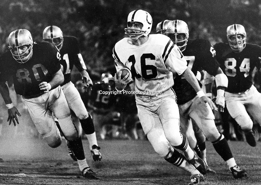 Oakland Raiders vs. Baltimore Colts Aug 8,1970.<br />Colt QB chased by #80 Art Thoms, #67? and #84 Tony Cline. (photo by Ron Riesterer)