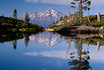 Mt. Shasta, 14,162 foot elevation, reflected in a lake, Mt. Shasta Wilderness, California, USA