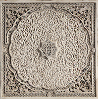 Intricately carved stucco work in the mihrab of the Al-Attarine Madrasa, a religious school built 1323-25 by the Marinid Sultan Uthman II Abu Said, who ruled 1310-31, in the medina of Fes, Fes-Boulemane, Northern Morocco. The medina of Fes was listed as a UNESCO World Heritage Site in 1981. Picture by Manuel Cohen