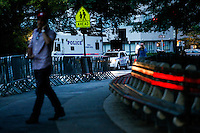 A man talks on his phone near a NYPD's truck while police patrol the streets of central park in New York.  06/05/2015. Eduardo MunozAlvarez/VIEWpress
