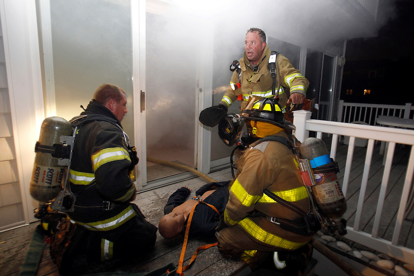 .Manasquan firefighters practice response to working structure fire at an oceanfront home slated for demolition at the Boro's north end.  (10/7/2010) MANASQUAN, NJ   photo by Andrew Mills