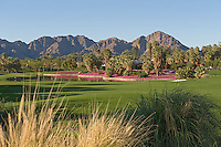 Golf course with mountains in background