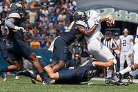 Pitt linebackers Oluwaseun Idowu and Quintin Wirginis tackle Penn State quarterback Trace McSorley. The Pitt Panthers defeated the Penn State Nittany Lions 42-39 at Heinz Field, Pittsburgh, Pennsylvania on September 10, 2016.