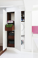 Recycling bins and washing machines are concealed in fitted cupboards