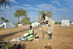 Women prepare food in an internally displaced persons camp in Aweng, South Sudan. Families started arriving here shortly after fighting broke out in December 2013, and new families continued to arrive in March 2014 as fighting continued. The ACT Alliance is providing the displaced families and the host communities affected by their presence with a variety of support.