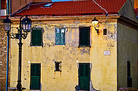 A yellow house in Alghero, Sardinia at dusk