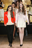 Fashion designer Paulina Polonyova, walks runway with models at the close of her fashion show, during the Slovak Fashion Night, May 13, 2011.