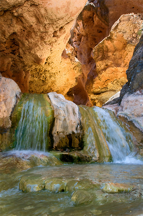 The creek in Travertine Canyon tumbles over waterfalls and through a slot canyon before reaching the Colorado River in Grand Canyon.