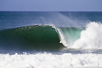 Pipeline, Haleiwa, Oahu, Hawaii (Saturday January 22, 2011) .The 6'-10 west swell continued to hit the North Shore today with Pipeline and Backdoor  breaking. Photo: joliphotos.com
