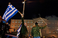 Farmers protest in front of the Greek parliament during a rally in Athens February 12, 2016. <br /> Farmers from across Greece gather in Athens for a two-day protest against the government and its plans to impose new tax hikes and pension charges.