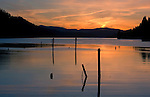 Pilings reflected in the evening waters of Wolf Lodge Bay on Lake Coeur d' Alene, Idaho.