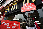 A woman shouts slogans for strike while Fast food workers take part in a  protest for Increased their wages in New York, April 04, 2013. Photo by Eduardo Munoz Alvarez / VIEWpress.