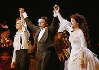 Actor Robert Guillaume, center, smiles as he takes a curtain call for his performance as the Phantom in the Los Angeles production of ?The Phantom of the Opera,? May 2, 1990. It was the first night Guillaume performed the Phantom role, replacing Michael Crawford. (AP Photo/Alan Greth)