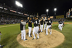 CHICAGO - JUNE 23:  Alexei Ramirez #10, Gordon Beckham #15 and other members of the Chicago White Sox celebrate after the game against the Milwaukee Brewers on June 23, 2012 at U.S. Cellular Field in Chicago, Illinois.  The White Sox defeated the Brewers 8-6.  (Photo by Ron Vesely)  Subject:  Alexei Ramirez; Gordon Beckham