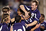 11 November 2005: Duke' Blake Camp (being held by #15 Ryan Pascioni) is mobbed by teammates following his second goal of the match, a header in the 16th minute which gave Duke a 2-0 lead. Duke University defeated the University of Maryland 4-2 at SAS Stadium in Cary, North Carolina in a semifinal of the 2005 ACC Men's Soccer Championship.
