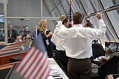 Kennedy Space Center, FL - July 4, 2006 -- In Firing Room 4 of the Launch Control Center, Shuttle Launch Director Mike Leinbach (foreground) cheers over the successful liftoff of Space Shuttle Discovery, watching it rocket through the sky on mission STS-121 -- the first ever Independence Day launch of a space shuttle. At far left is Stephanie Stilson, NASA flow director, who began conducting Discovery's processing operations in December 2000. .Credit: Kim Shiflett - NASA via CNP