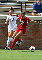WINSTON-SALEM, NORTH CAROLINA - September 01, 2013:<br />  Devyn Ciotti (21) of Louisville University moves the ball away from Caroline Wootten (15) of Wake Forest University during a match at the Wake Forest Invitational tournament at Wake Forest University on September 01. The match was abandoned early in the second half due to severe weather with Wake leading 1-0.