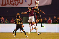 Mexico national team defender Rafael Marquez (4) beats Alejandro Moreno (15) forward for Venezuela to a headball. The national teams of Mexico and Venezuela played to a 1-1 draw in an International friendly match at  Qualcomm stadium in San Diego, California on  March 29, 2011...