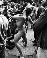 Crowd pays no attention to nude girl at May Day celebration at Provo Park in Berkeley, Ca, crowd is more interested in speaker than naked girl. (May 1, 1977 photo/Ron Riesterer)