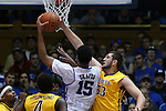 29 December 2014: Toledo's Nathan Boone (53) blocks a shot by Duke's Jahlil Okafor (15). The Duke University Blue Devils hosted the University of Toledo Rockets at Cameron Indoor Stadium in Durham, North Carolina in a 2014-16 NCAA Men's Basketball Division I game. Duke won the game 86-69.