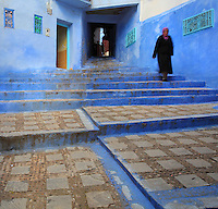 Stepped street in the medina or old town of Chefchaouen in the Rif mountains of North West Morocco. Chefchaouen was founded in 1471 by Moulay Ali Ben Moussa Ben Rashid El Alami to house the muslims expelled from Andalusia. It is famous for its blue painted houses, originated by the Jewish community, and is listed by UNESCO under the Intangible Cultural Heritage of Humanity. Picture by Manuel Cohen
