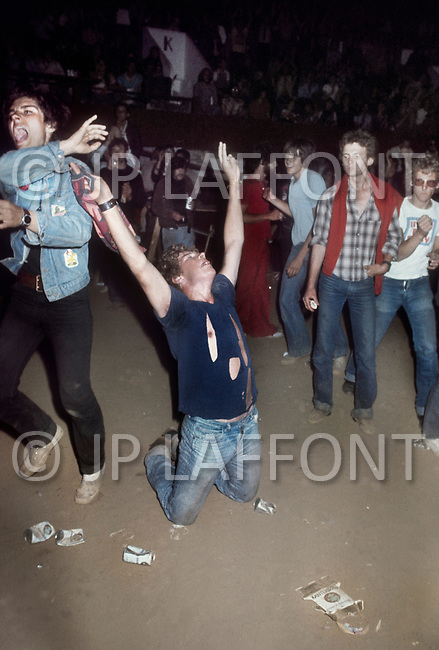 "Mont de Marsan, France. August 7th, 1977. Young crowds at the second edition of the first European Punk Rock Festival at Mont De Marsan. Although the ""punks""  were ambiguous and controversial, they did not trouble the surrounding cites , as some people feared."