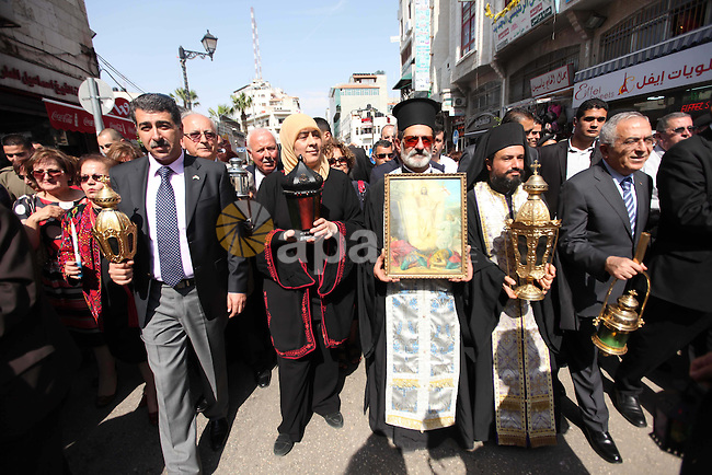 "Palestinian Prime Minister Salam Fayyad joins Christian Orthodox annual celebrations of the ""Holy Fire"" in the West Bank city of Ramallah May 4, 2013. Photo by Issam Rimawi"
