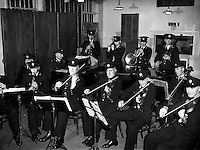 Garda Ceilidh Band - Special fo radio Review.31/01/1957..The Garda Band is a public relations branch of the Garda S&iacute;och&aacute;na, and was formed shortly after the foundation of the force. It gave its first public performance on D&uacute;n Laoghaire Pier on Easter Monday, 1923. The first Bandmaster was Superintendent D.J. Delaney and he formed a c&eacute;il&iacute; and pipe band within the Garda Band. In 1938, the Dublin Metropolitan Garda Band (based at Kevin Street) and the Garda Band amalgamated and were based at the Garda Headquarters in Phoenix Park..The band was disbanded in 1965. However to celebrate the 50th anniversary of the foundation of the Garda S&iacute;och&aacute;na it was reformed in 1972..Besides providing music for official Garda functions (such as Graduation Ceremonies at the Garda College) the band undertakes a community orientated programme each year performing at schools, festivals and sporting events. It has a long association with Lansdowne Road for Rugby union and Soccer Internationals, as well as Croke Park and the G.A.A., the St. Patrick's Day Parade in Dublin and the Rose of Tralee Festival..In 1964 the band toured America and Canada under Superintendent J. Moloney, and has also traveled to international events and represented the country at police festivals and concerts in Switzerland, Germany and Northern Ireland.