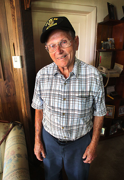 Norwood Wilson sits on his small farm in Richlands and reflects on his days in the  Korean War.