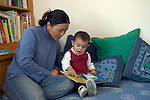 Berkeley CA Nepalese mother and daughter, nineteen-months-old, identifying animals in picture book, child pointing and naming MR
