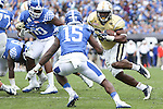 Running back Dedrick Mills #26 of the Georgia Tech Yellow Jackets runs with the ball during the second half of the TaxSlayer Bowl against the Kentucky Wildcats at EverBank Field on Saturday, December 31, 2016 in Jacksonville, Florida. Photo by Michael Reaves | Staff.
