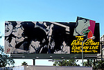 Rolling Stones billboard on the Sunset Strip for the record Love You Live with artwork by Andy Warhol, 1977