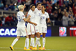 15 October 2014: Abby Wambach (USA) (20) celebrates her goal with Christen Press (USA) (14), Carli Lloyd (USA), and Megan Rapinoe (USA) (15). The United States Women's National Team played the Trinidad and Tobago Women's National Team at Sporting Park in Kansas City, Kansas in a 2014 CONCACAF Women's Championship Group A game, which serves as a qualifying tournament for the 2015 FIFA Women's World Cup in Canada. The United States won the game 1-0.