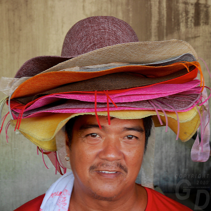 Selling Straw hats street vendor in the old part of Manila, Philippines
