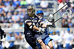 DURHAM, NC - APRIL 08: Notre Dame's Mikey Wynne (24) and Duke's Ethan Powley (behind). The Duke University Blue Devils hosted the University of Notre Dame Fighting Irish on April 8, 2017, at Koskinen Stadium in Durham, NC in a Division I College Men's Lacrosse match. Duke won the game 11-8.