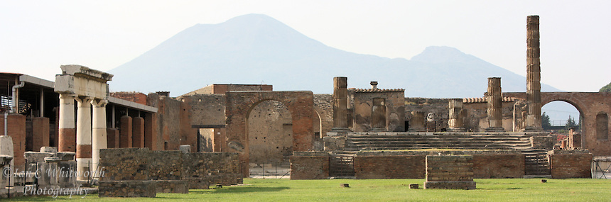With Mount Vesuvius in the background, a panoramic view of the ruins at Pompeii