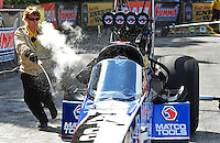 May 15, 2011; Commerce, GA, USA: A member of the NHRA safety safari sprays out a header fire on the car of top fuel dragster driver Antron Brown during the Southern Nationals at Atlanta Dragway. Mandatory Credit: Mark J. Rebilas-