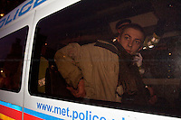 Protester (arrested) - 2011<br /> <br /> London, 29/01/2011. National demonstration organised by NCAFC (National Campaign Against Fees and Cuts) started their march from ULU (University of London Union) on Malet Street and continued via the Strand, Whitehall, Parliament Square, Millbank Center, and the Egyptian embassy. Thousands of students and trade union members protested against budget cuts in the public sector and increased education tuition fees being pushed through by the Con/Dem Government.