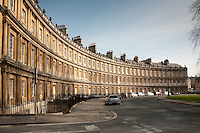 The Circus is an example of Georgian architecture in the city of Bath, Somerset, England, begun in 1754 and completed in 1768. The name comes from the Latin 'circus', which means a ring, oval or circle..The Circus, was designed by the architect John Wood the Elder, although he never lived to see his plans put into effect as he died less than three months after the first stone was laid. It was left to his son, John Wood the Younger to complete the scheme to his father's design...Wood's inspiration was the Roman Colosseum, but whereas the Colosseum was designed to be seen from the outside, the Circus faces inwardly. The circus consists of 3 storey townhouses and mansard. 3 or 4 windows. Divided into 3 blocks, all of the same size but each with a different number of houses. Three classical Orders, (Greek Doric, Roman/Composite and Corinthian) are used, one above the other, in the elegant curved facades. The masonry between columns is not curved but this is not apparent.  The frieze of the Doric entablature is decorated with alternating triglyphs and 525 unique pictorial emblems in the metopes, including serpents, nautical symbols, devices representing the arts and sciences, and masonic symbols. The parapet is adorned with stone acorn finials...The Circus is constructed from Bath Stone is a Limestone comprising granular fragments of calcium carbonate its warm, honey colouring gives the  circus and much of Bath its distinctive appearance.