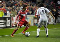 Chicago midfielder Marco Pappa (16) makes a move against Vancouver midfielder Davide Chiumiento (20).  The Chicago Fire tied the Vancouver Whitecaps 0-0 at Toyota Park in Bridgeview, IL on May 7, 2011.