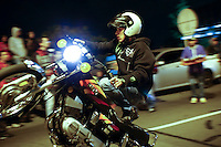 A motorcycle driver keeps his eyes on the road as he performs a pike at the zone known as las palmas in Medellin, Colombia. Jan 20, 2014. Adrenaline, danger and Noise come together, at nights to the sector of Las Palmas in Medellin. where an exhibition of pikes begins starring over a hundred motorcyclists which make their way in the middle of thousand of spectators round the road for don't lost any detail of the pirouettes. Photo by VIEWpress