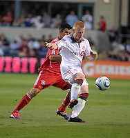 Toronto defender Richard Eckersley (27) plays the ball while being pressured by Chicago forward Orr Barouch (15).  The Chicago Fire defeated Toronto FC 2-0 at Toyota Park in Bridgeview, IL on August 21, 2011.