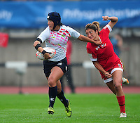 Aoi Kurokwa of Japan takes on the Canada defence. FISU World University Championship Rugby Sevens Women's Semi Final between Japan and Canada on July 9, 2016 at the Swansea University International Sports Village in Swansea, Wales. Photo by: Patrick Khachfe / Onside Images